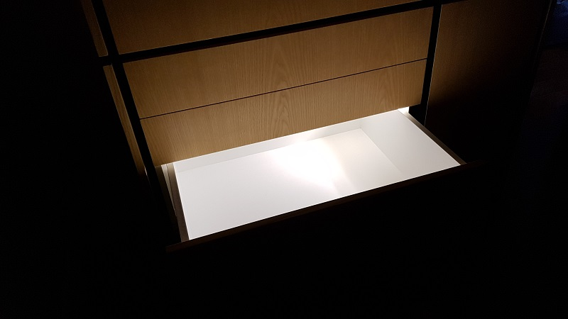 Drawer lighting with magnetic switched LED strip