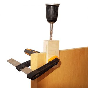 drilling a 10mm hole in the top of a door
