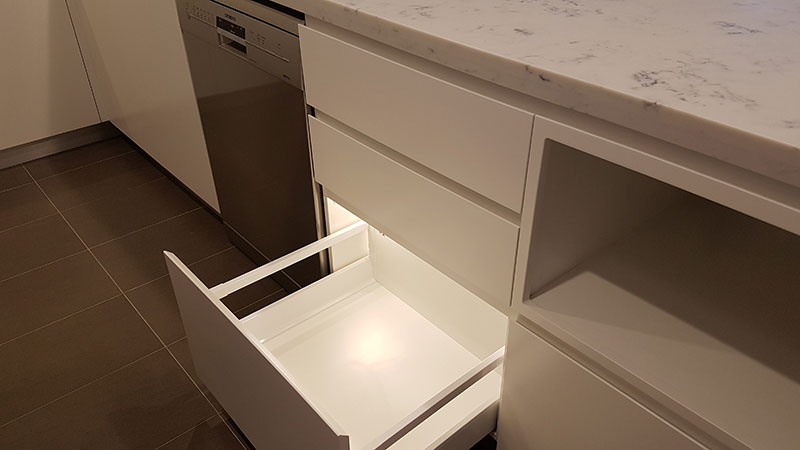 Drawer lighting with magnetic switched LED strip providing excellent ambience
