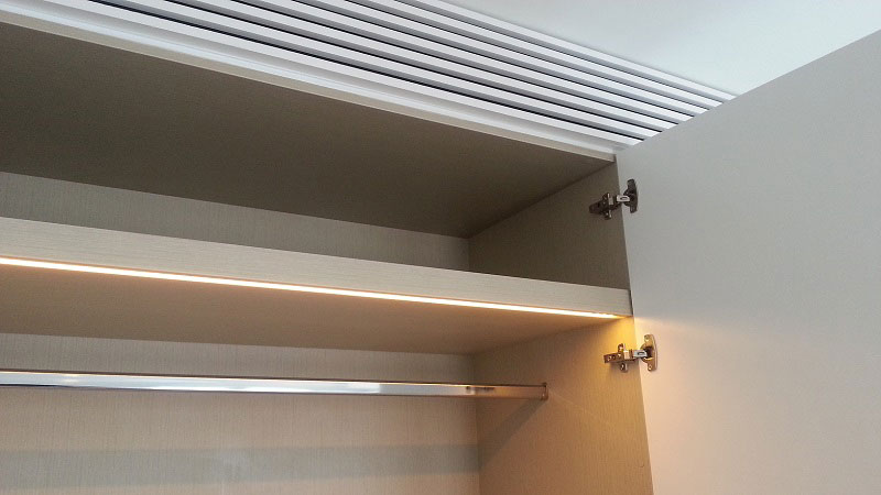Recessed LED strip controlled by concealed door activated magnetic sensor switch